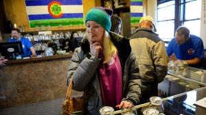 Woman at dispensary in Colorado Courtesy of money.cnn.com